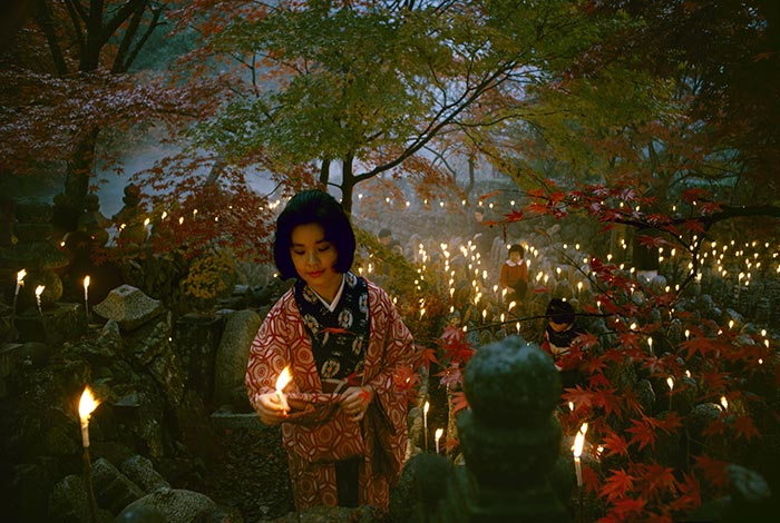 'Offerings to the unknown dead, Kyoto' [Toshi Satow offering a candle]. Taken for a series on Japan for 'Life', 1964, Kyoto, by Brian Brake. Gift of Wai Man Lau, 2010. Te Papa (CT.059863)