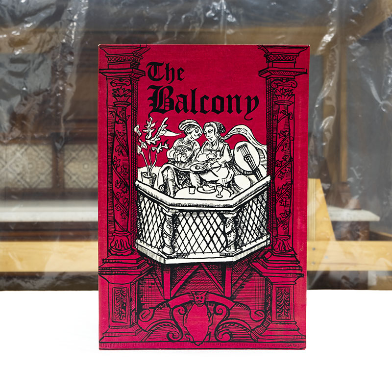 Print red print featuring black linocut-style Medieval drawing of two people sitting on a balcony