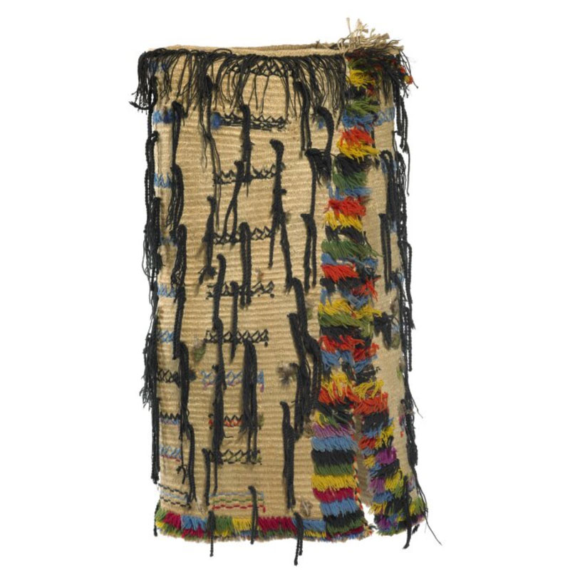 A woven cloak with colourful tassels added