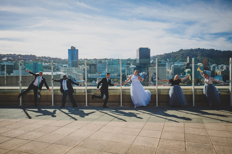 Wedding party group having photos overlooking Wellington Harbour
