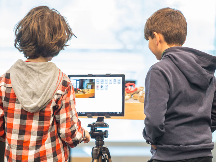 Children animate models using a camera