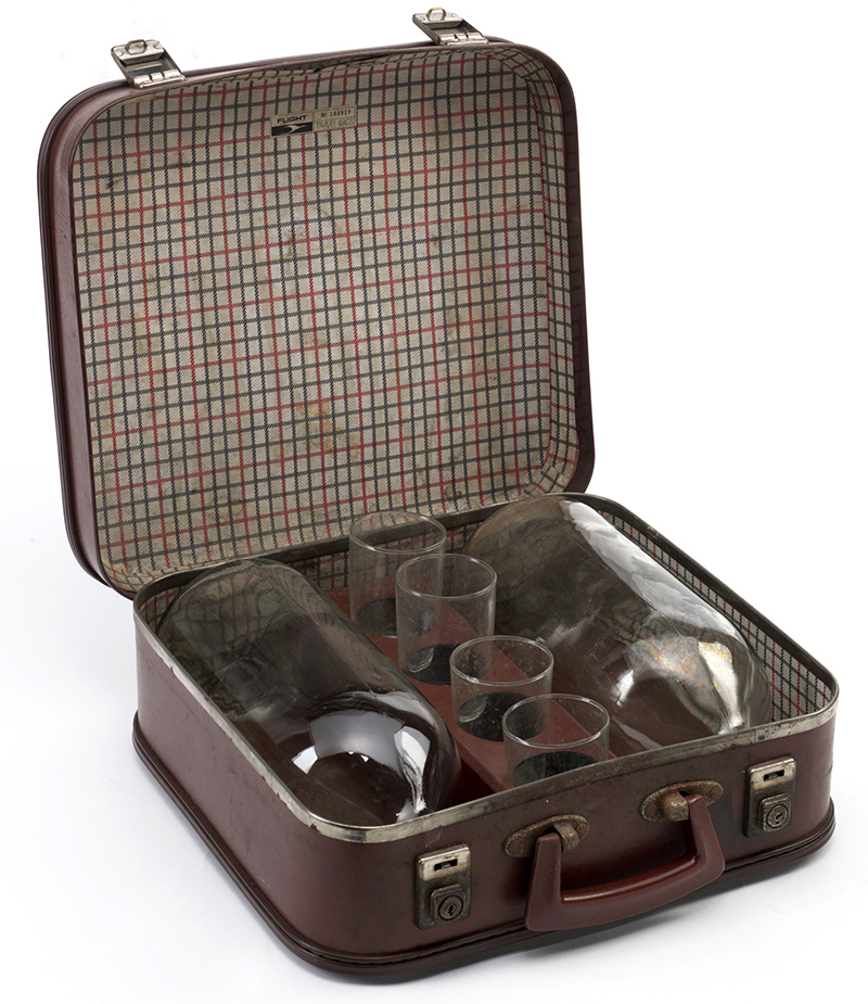 Two big bottles and four glasses in a born leather case with checked lining