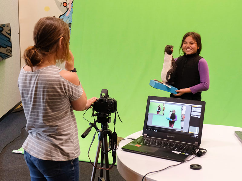 Students using green screen technology