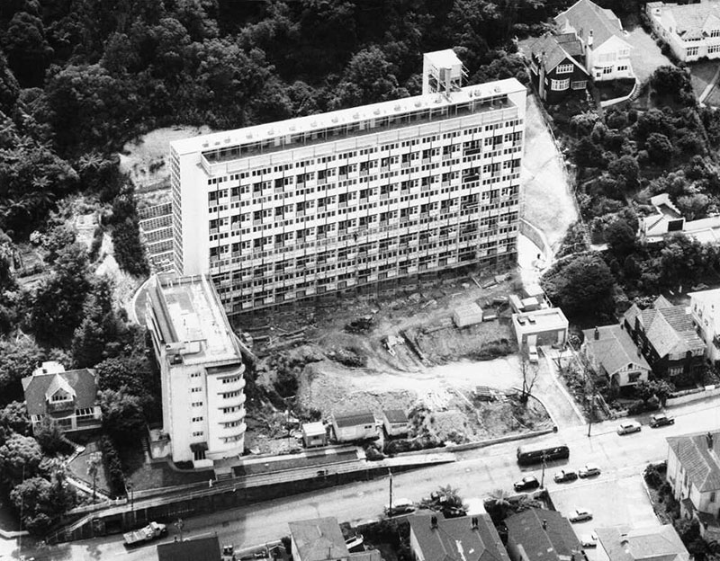 Black and white photo of an overhead view of a large apartment block