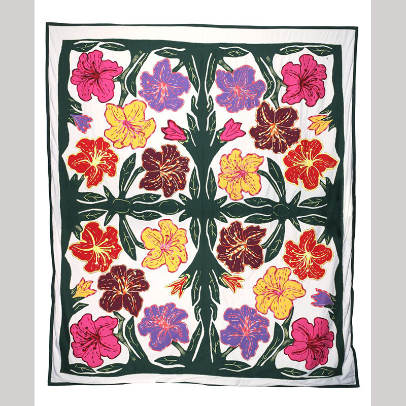 Brightly coloured pacific flowers arranged in a symmetrical pattern on a white background