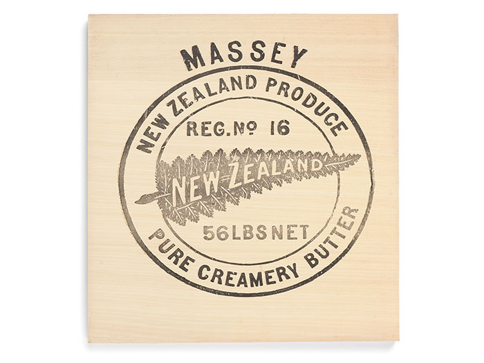 Butter box with a silver fern on it, and the words Massey New Zealand Produce Pure Creamery Butter