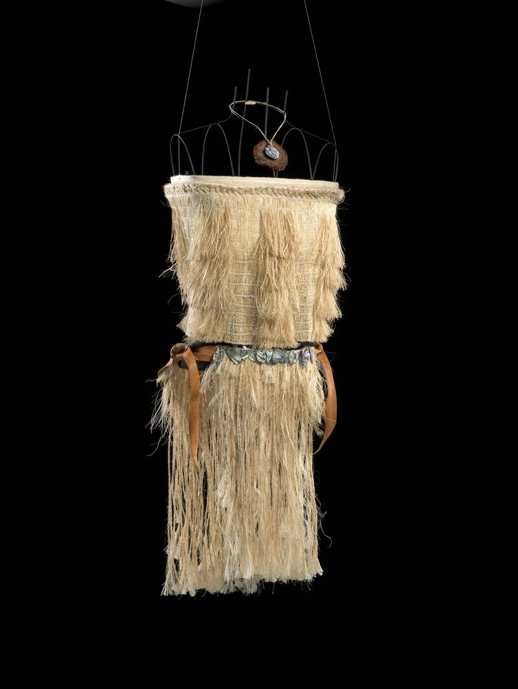 A woven bodice with shoulder straps and a woven skirt on a wire frame on a black background.