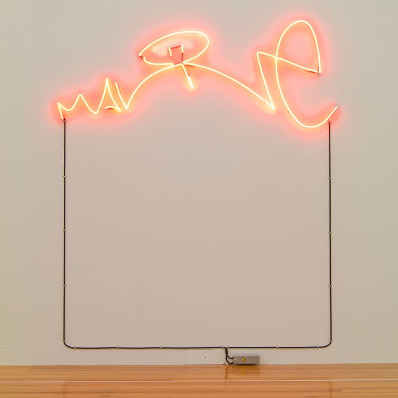 Neon lighting on a wall in the shape of the word Malone, scripted like a signature