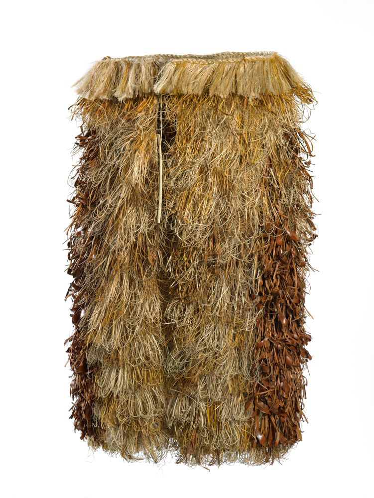 A round cloak on a frame tied at the top. It is made of flax, bird bone and glossy brown leaves.