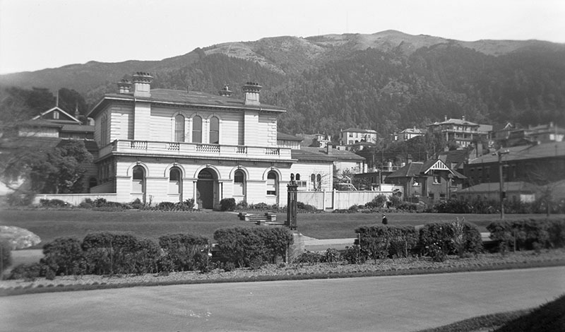 View of two-storey Colonial Museum, with Te Ahumairangi Hill in the background