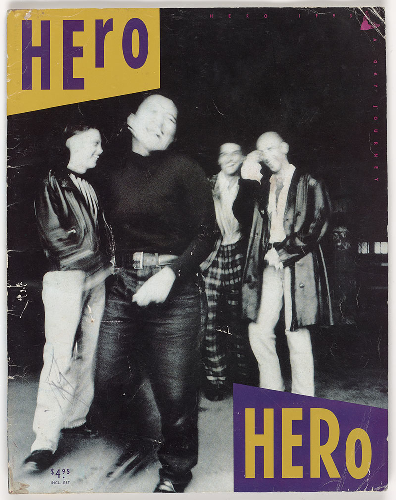 Photograph of a magazine. The cover is dominated by a black and white photo of four people standing casually, laughing. In the top-left corner is the word Hero in purple on yellow, with the opposite (Hero in yellow on purple) in the bottom right corner.