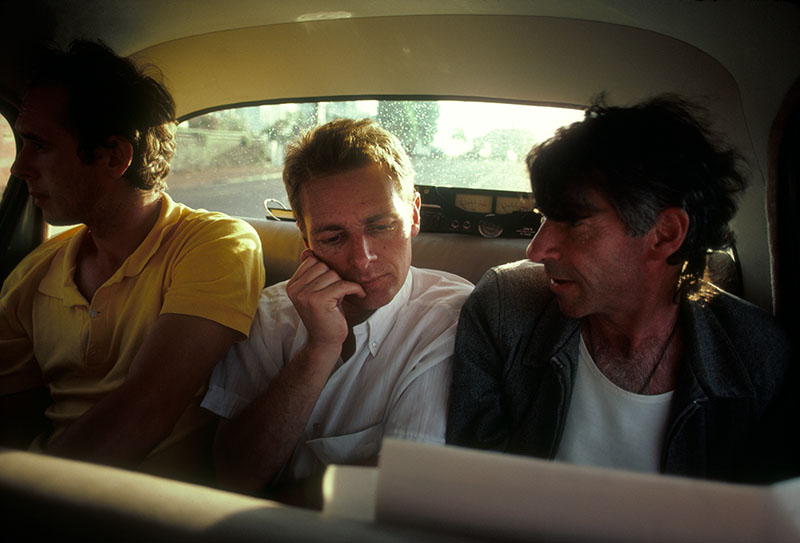Chris Barrett, Martin Rumsby, and Tony Fomison in the back seat of a car