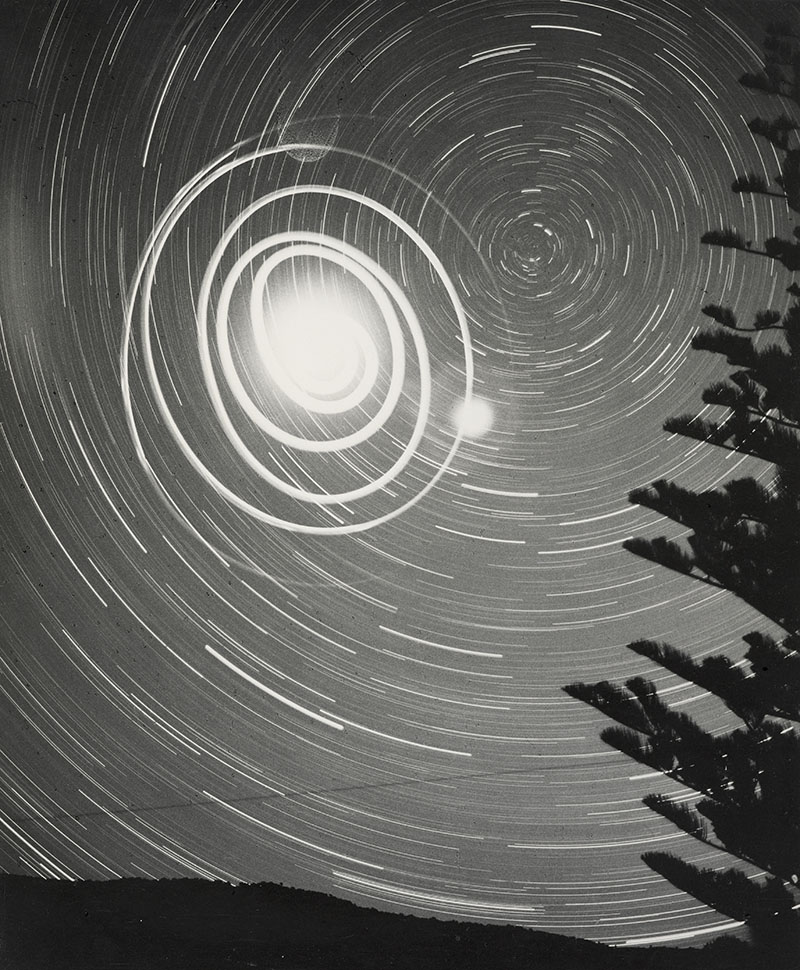 Black and white long exposure photograph of a star trail