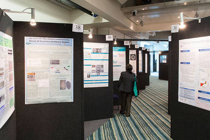 Oceania - Showing posterboards at a conference