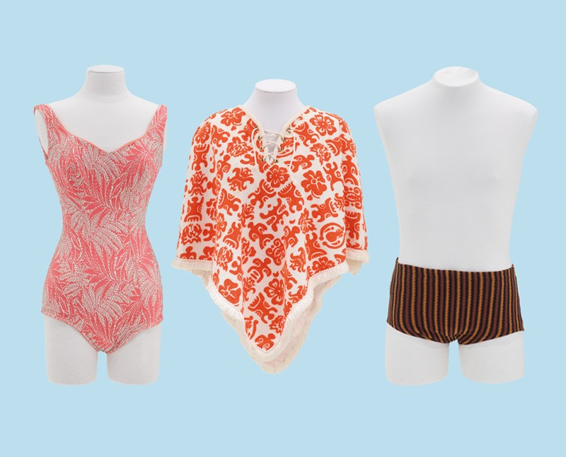 Three varieties of swimwear, including a man's and a woman's bathing costume and a poncho