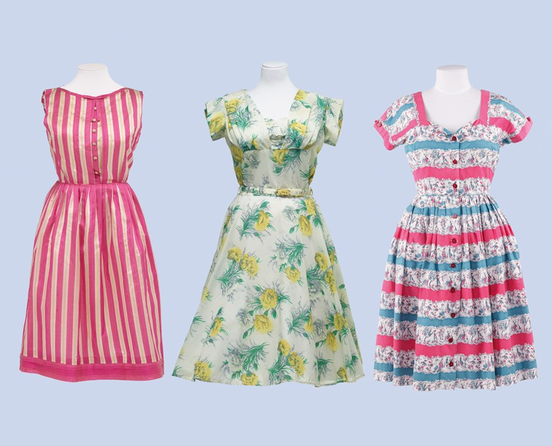 Three vibrant women's dresses