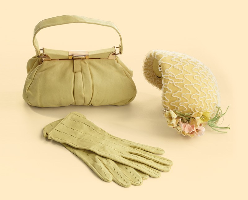 A summer hat, gloves, and handbag
