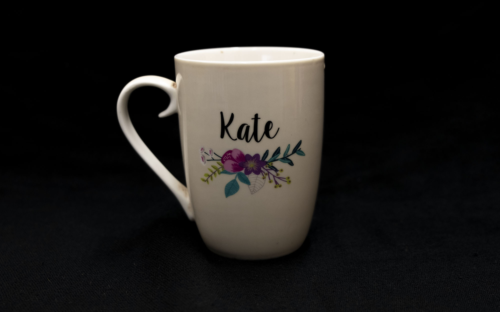 "Large cup that says ""Kate"" and has a picture of flowers on it"