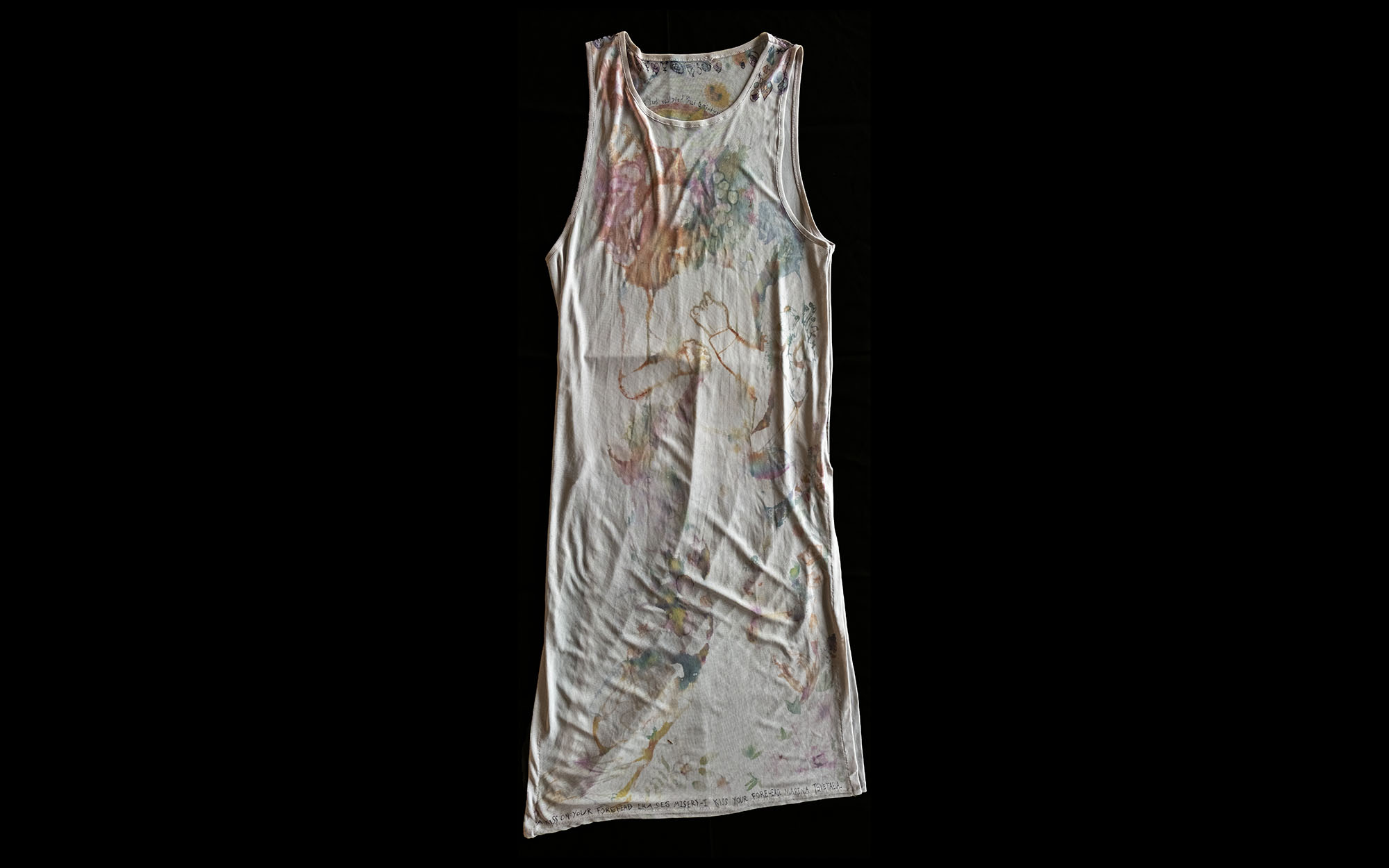 Dress with an array of colourful pictures drawn on it