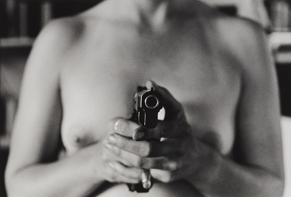Naked woman with gun