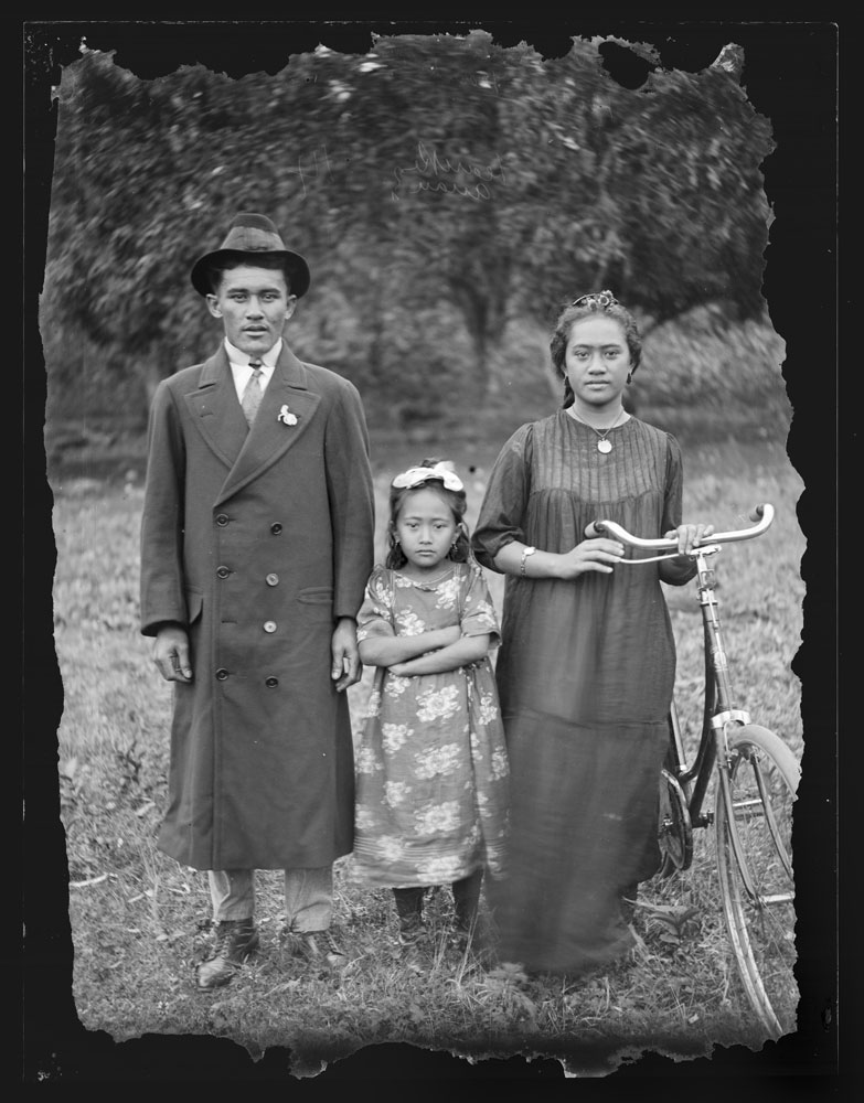 Family stand with a bike