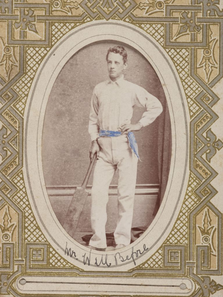 Ornately framed image of man with cricket bat