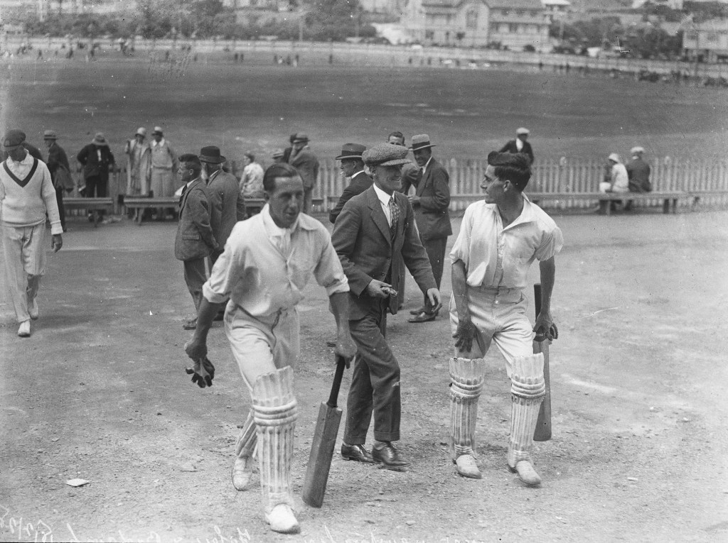 Cricketers exiting the pitch