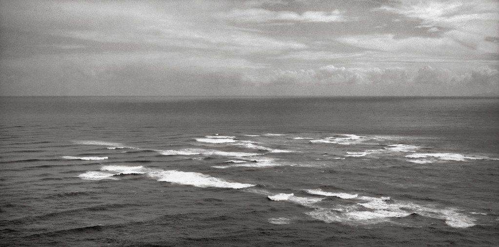 Black and white photograph of the sea