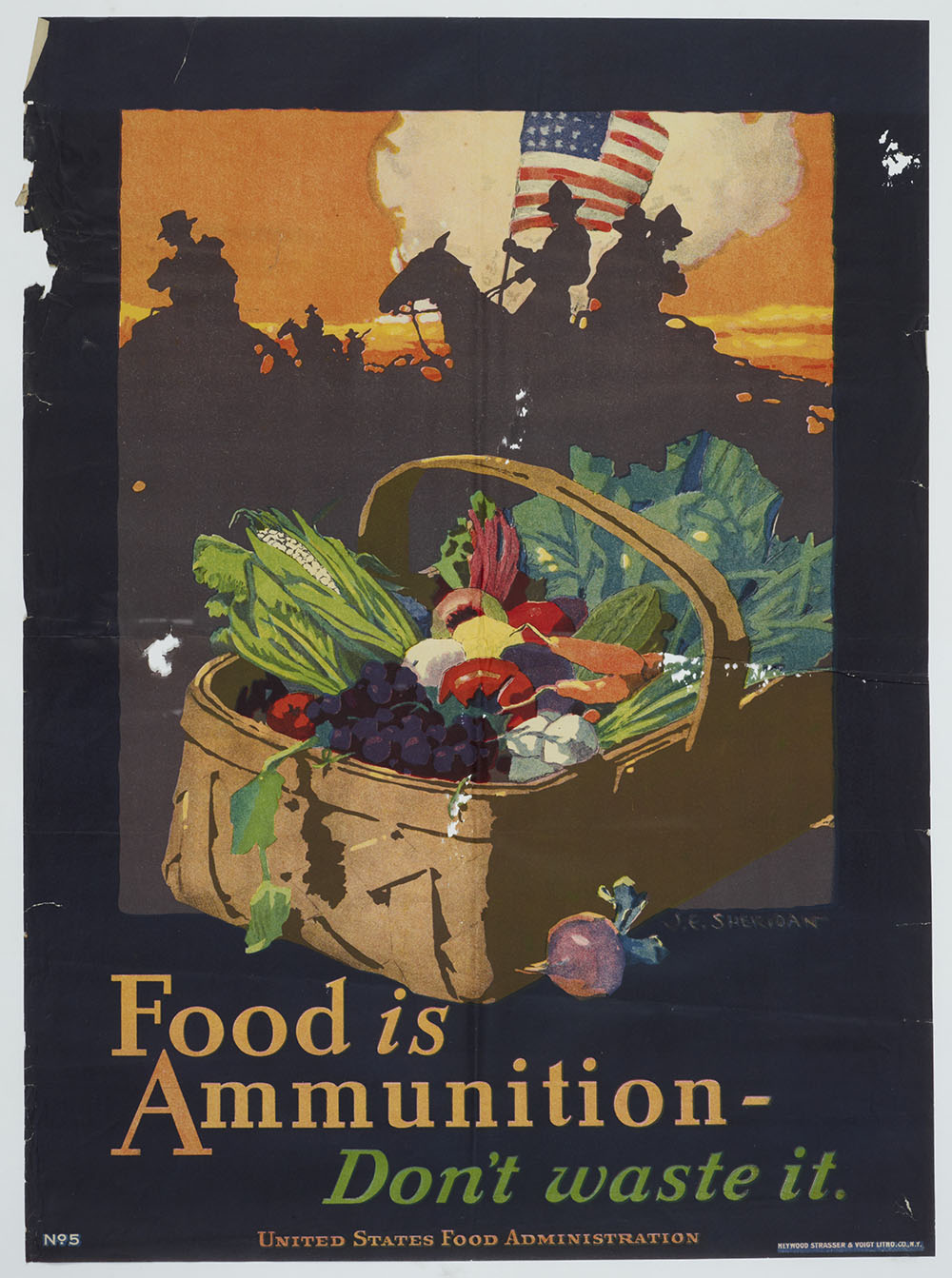 Poster featuring a basket of food and the words 'Food is ammunition - don't waste it'