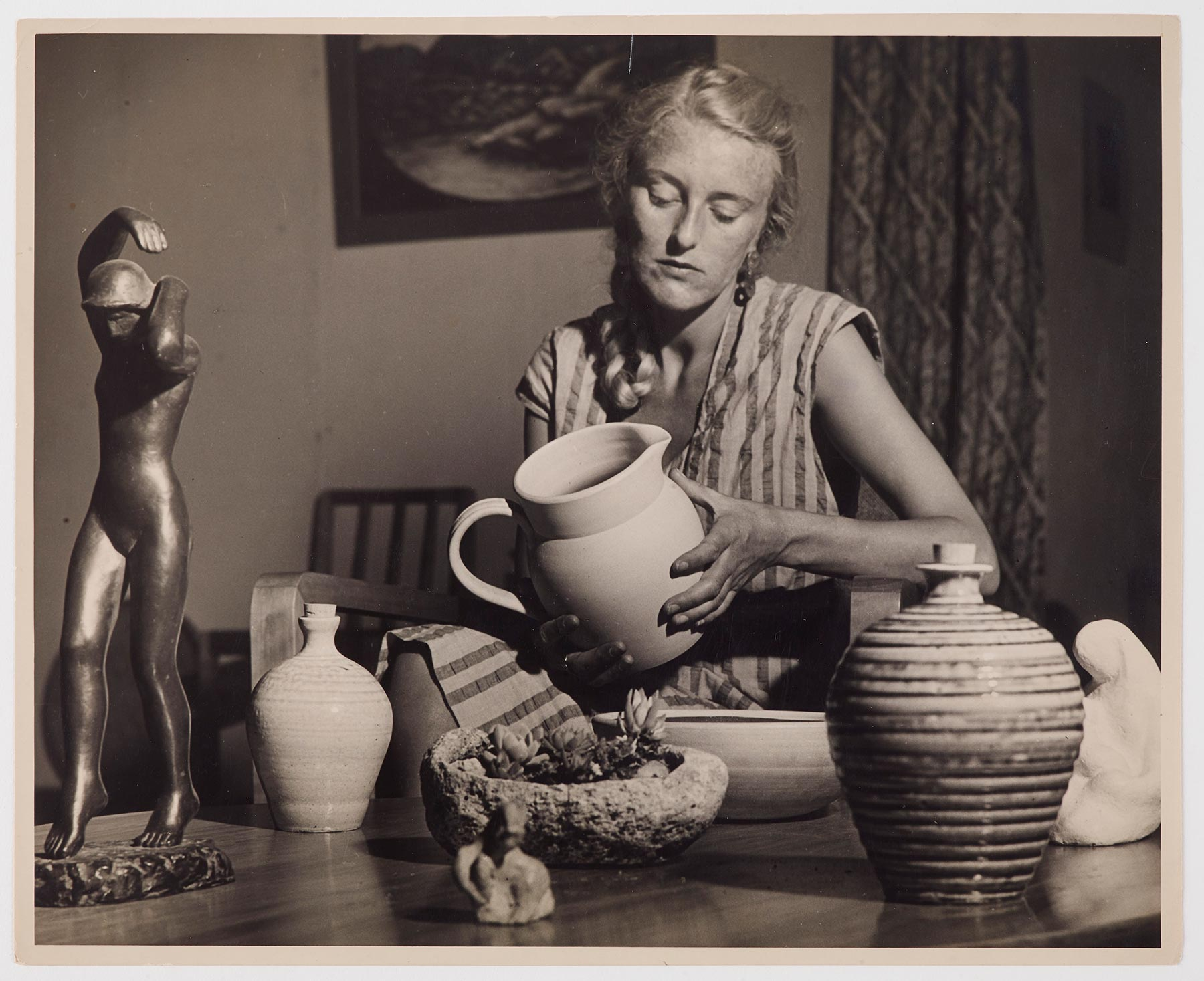 Helen Hitchings examining pottery