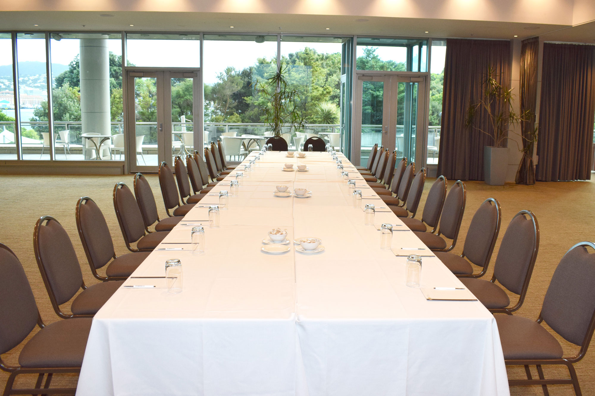 Icon function and meeting space set up with a long table