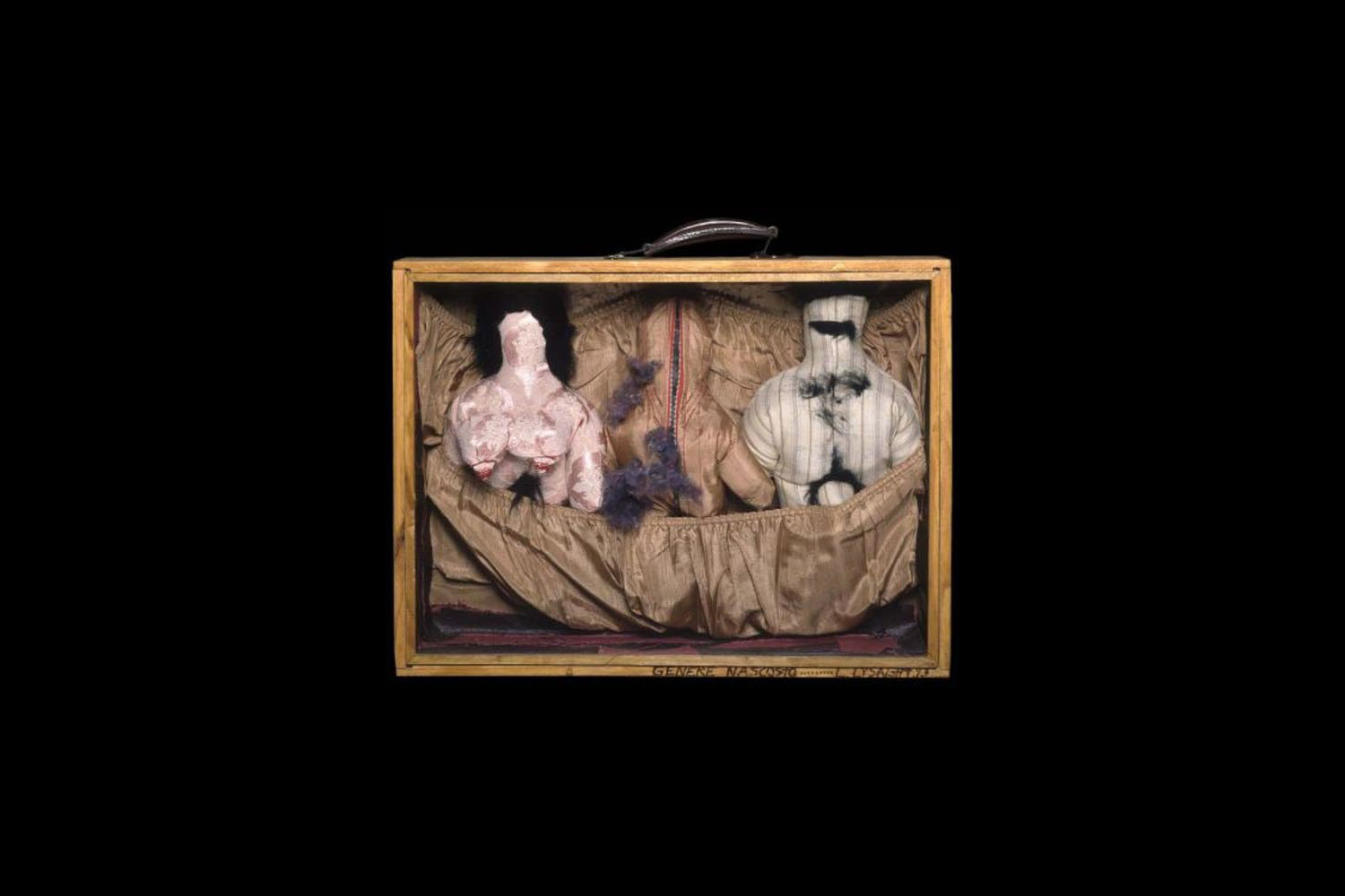 Wooden suitcase frame contains sewn naked male and female dolls