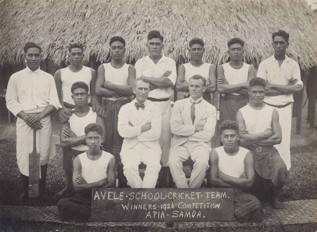 A Samoan cricket team pose with their arms crossed