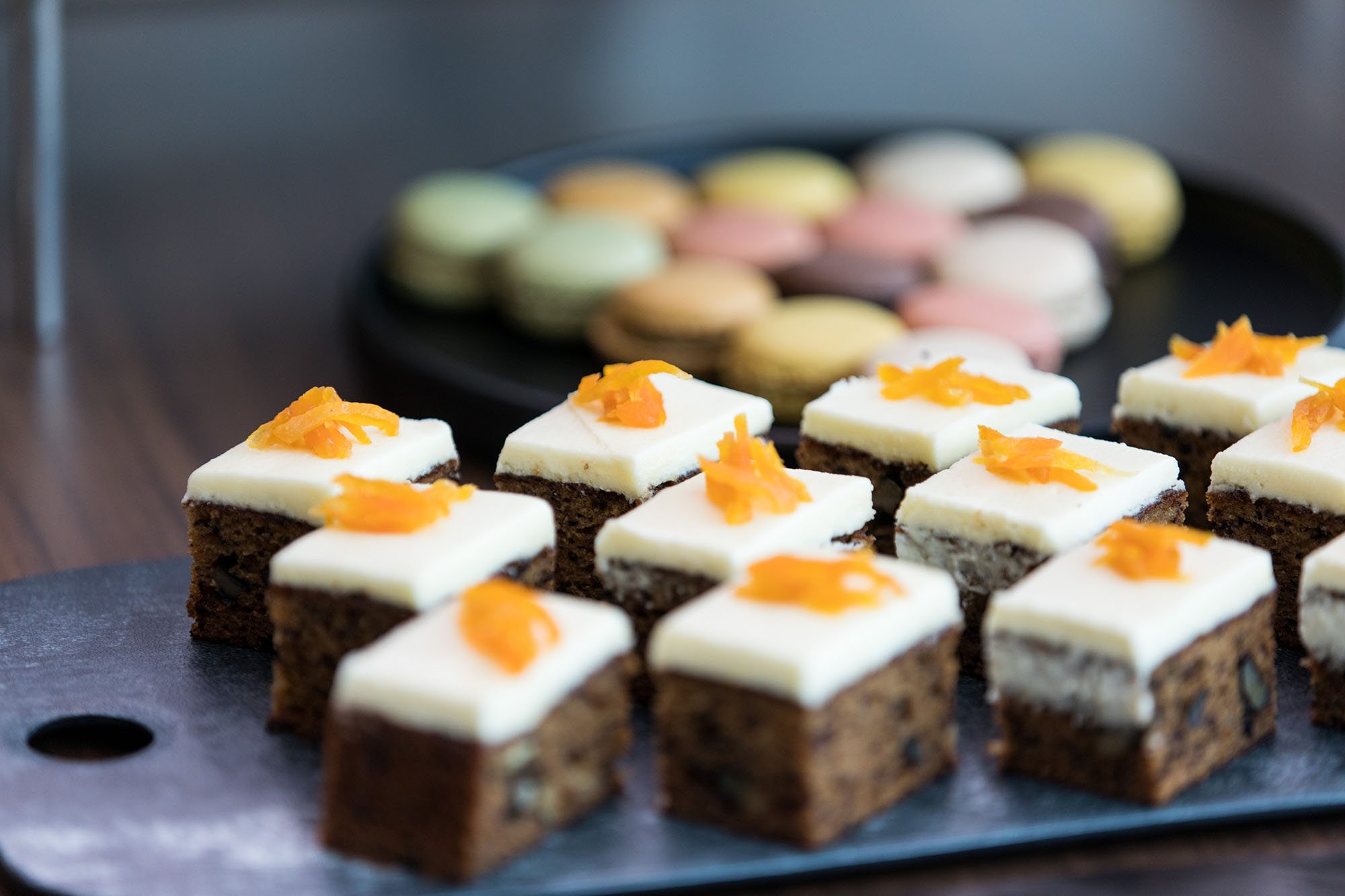 A selection of squares of carrot cake on a plate