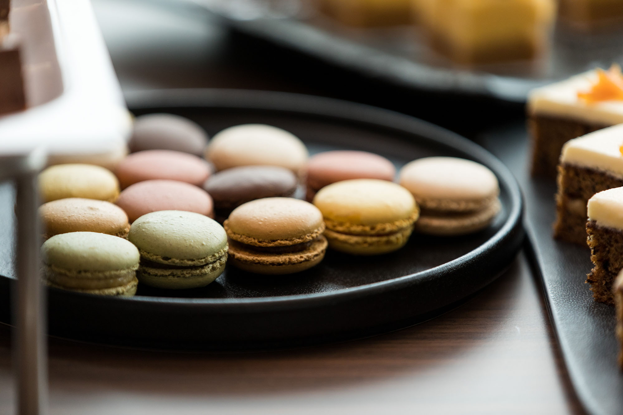 A plate of different coloured macaron biscuits
