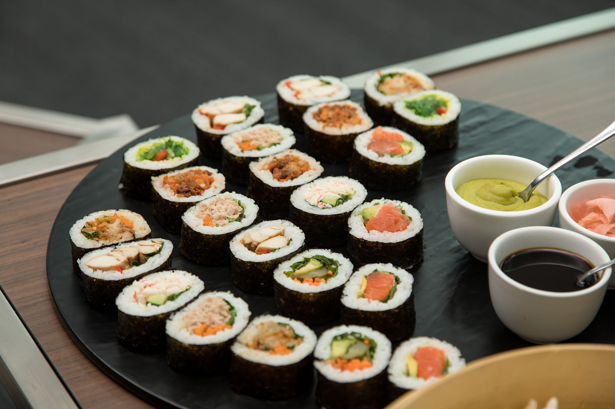 An array of types of sushi rolls on a plate