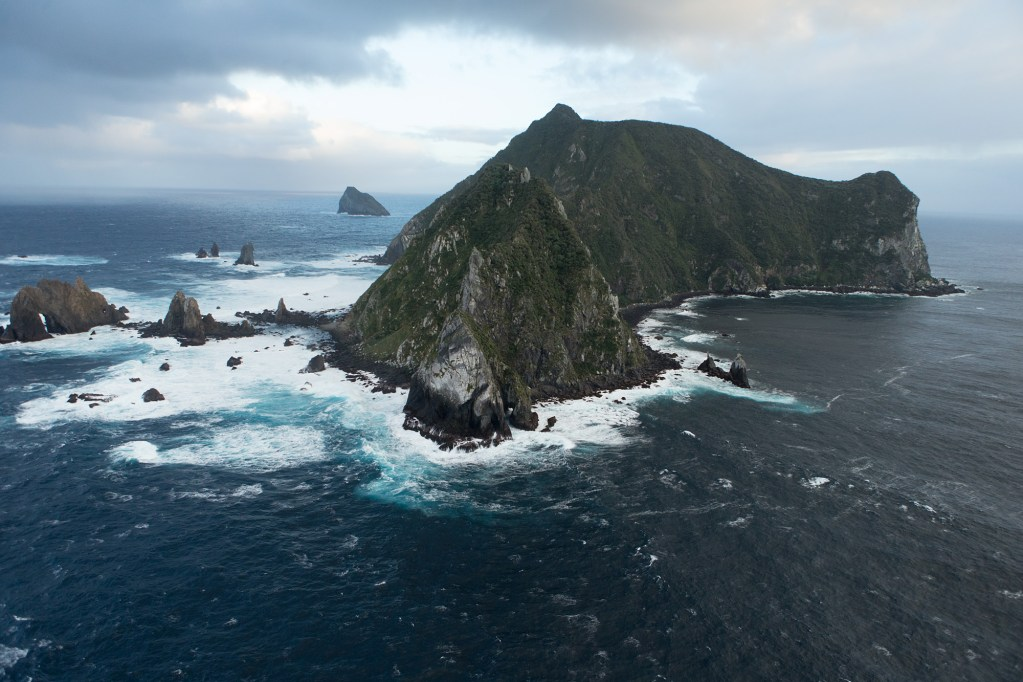 Cliffs and rough sea of Solander Island