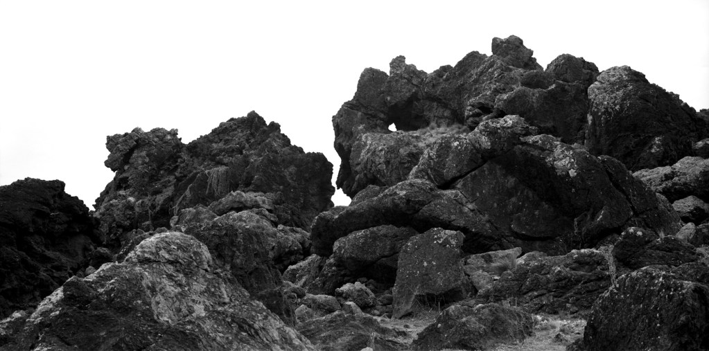 Black and white photograph of rocks at Cape Palliser, Wairarapa