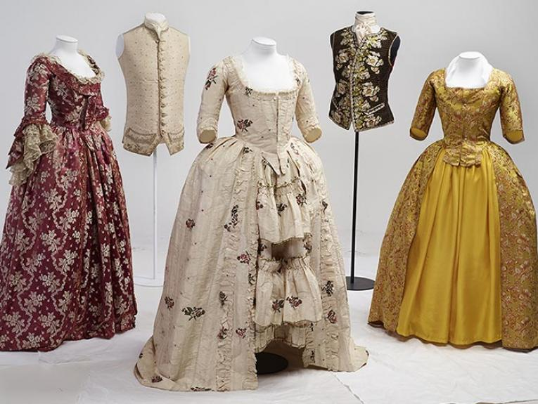 Close-up of dresses mounted for display