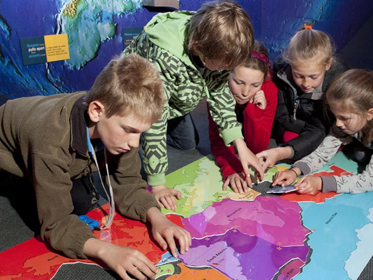 Children interact with representations of tectonic plates