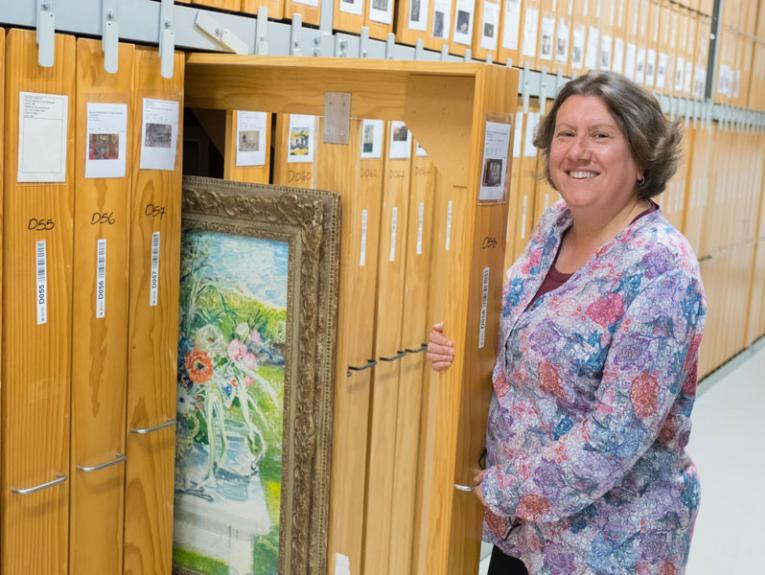 Anna Brookes in the art storerooms