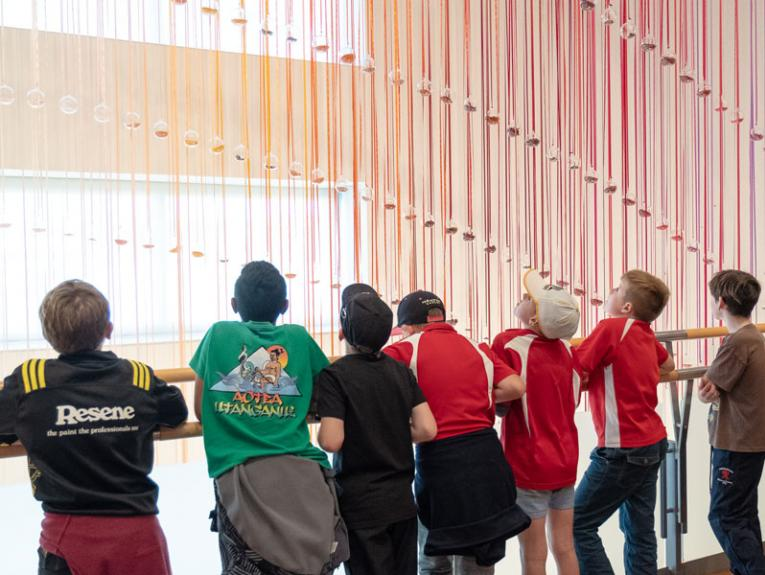 Kids look at art
