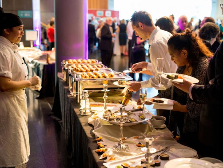 People tucking into a buffet