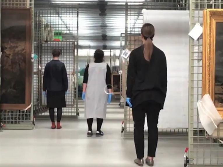 Te Papa curators dance with art works in the store room