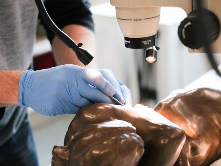 Conservation work being carried out on a bronze sculpture