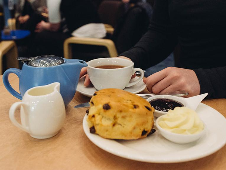 Devonshire tea being eaten in the cafe
