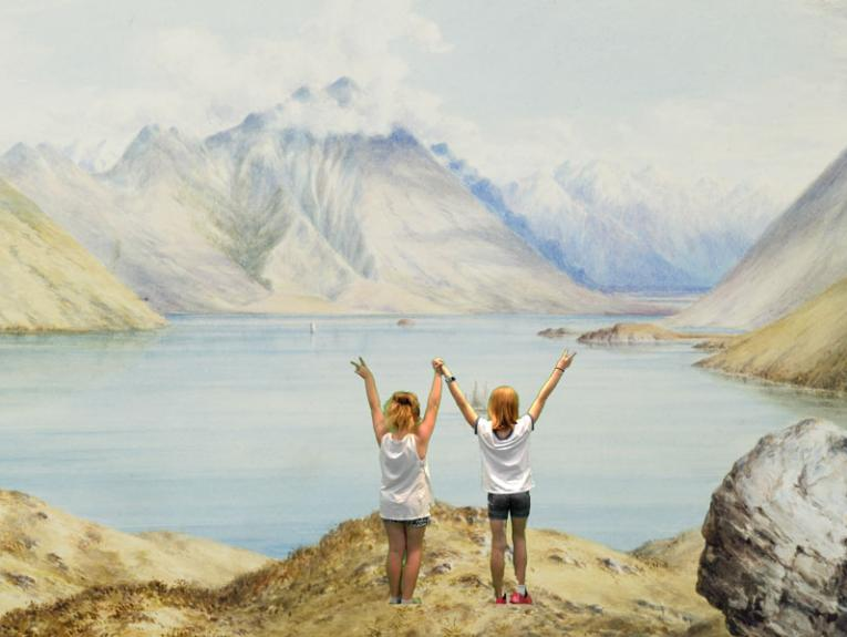 Two girl in a watercolour painting of mountains