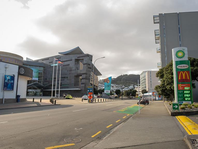 Wide shot of the entrance to Te Papa from Cable St showing the road you enter to drive into the carpark