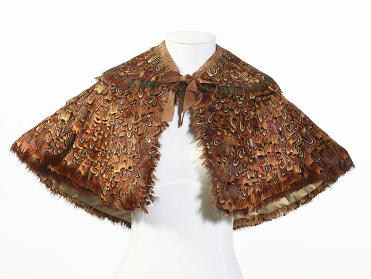 A hand-stitched feather pelerine with a detachable collar, using pheasant feathers
