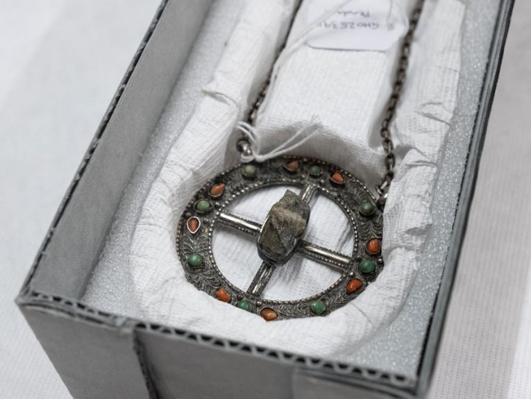 Silver pendant with a rock in the middle